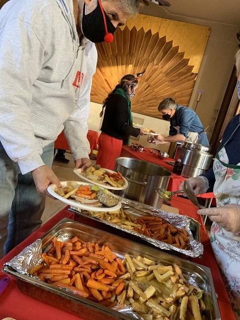 people serving Christmas dinner